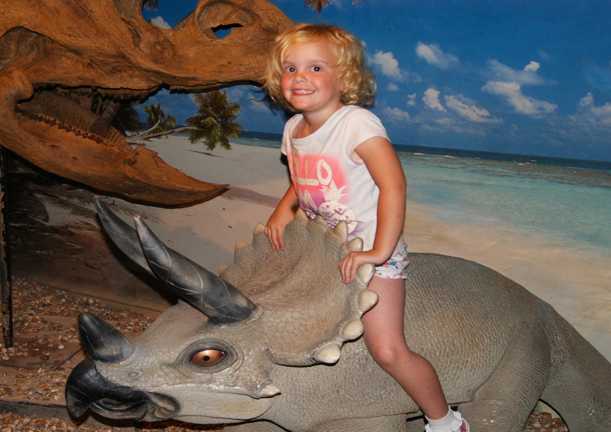 Sit on a baby Triceratops